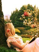 Blonde-Girl-Reading-Book-Under-Tree
