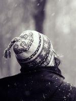 Girl-Looking-At-Falling-Snow