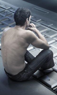 Man-Sitting-On-Keyboard