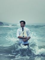 Man-With-Ship-In-Hands-And-Ocean-Waves-Around-Him