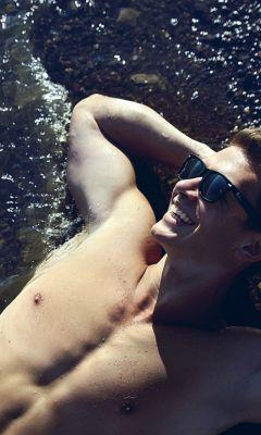 Man-Sunbathing-Beach