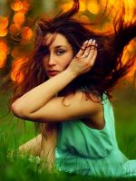 Girl in green with flowing hair