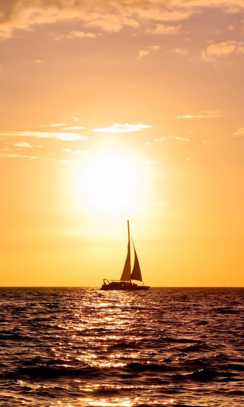 Ship On Sunset Sea
