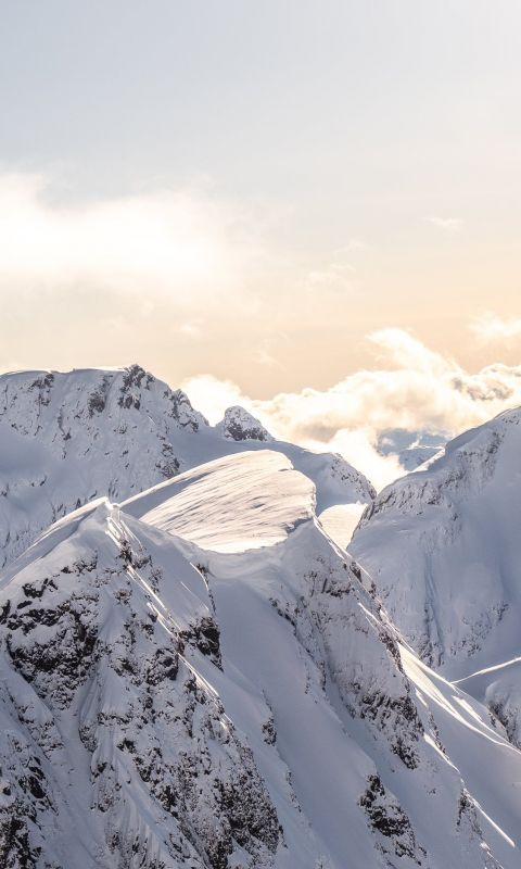mountains covered by snow at daytime wallpaper