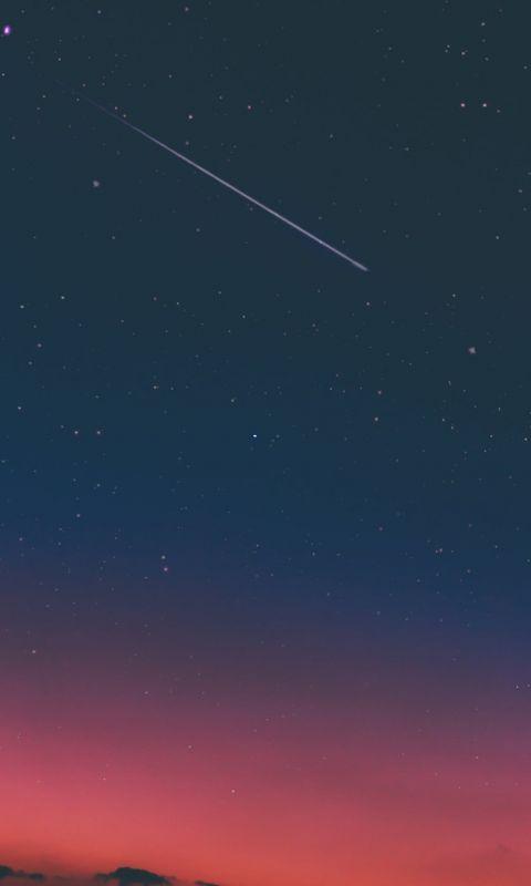 shooting star in night sky wallpaper