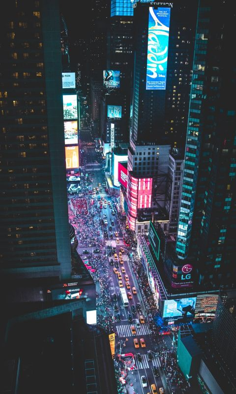 aerial photo of a busy city during night time wallpaper