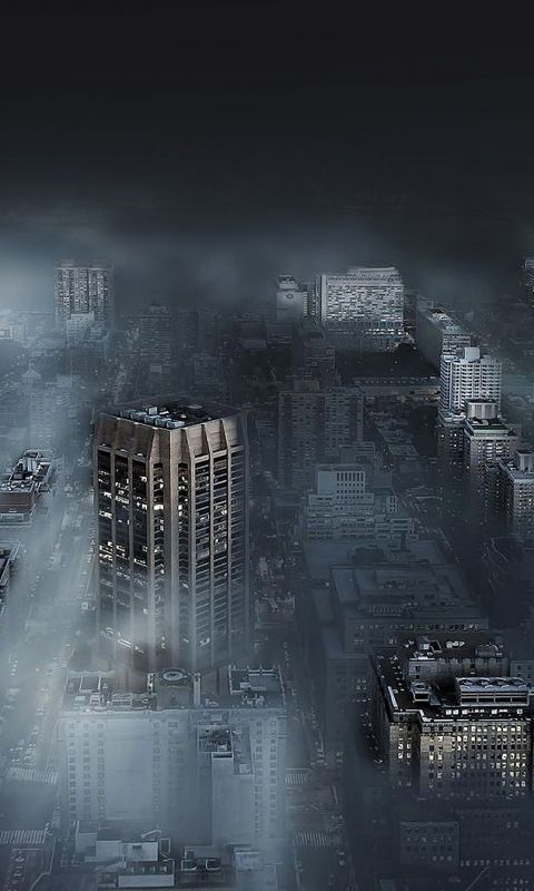 Dark city in fog wallpaper