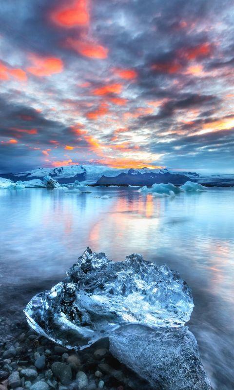 block of ice near water wallpaper