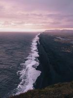 waves crashing on shore under cloudy sky during da... wallpaper