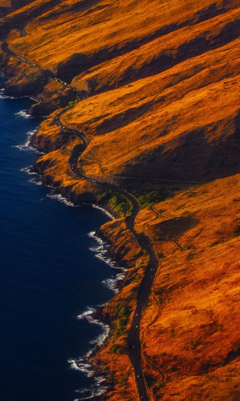 aerial photography of road on mountain near seasho... wallpaper