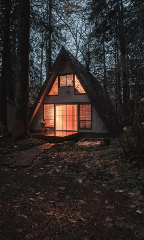 An A Frame home at night in the Mount Hood area wallpaper