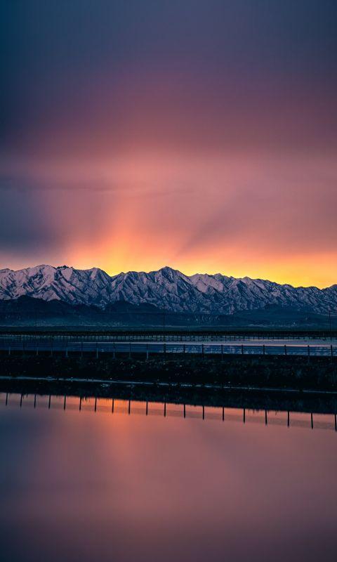 A beautiful sunrise coming over Farnsworth Peak ju... wallpaper