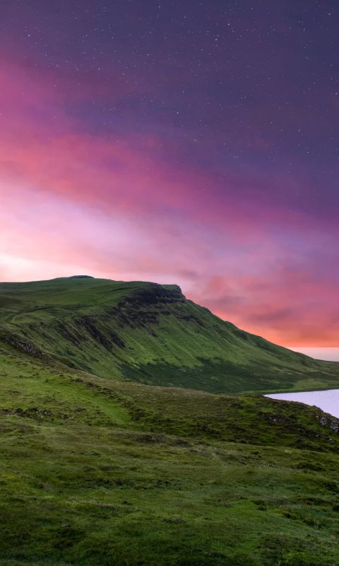 green mountain under purple sky wallpaper