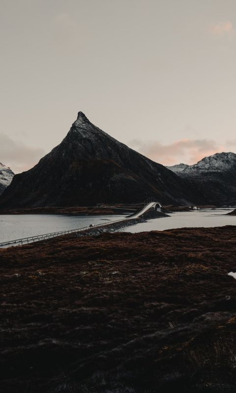 mountains beside bridge wallpaper
