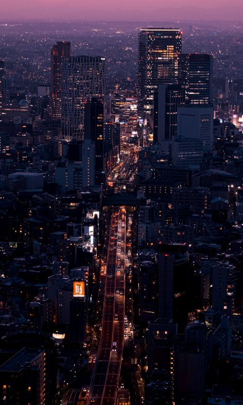 aerial view of city buildings during night time wallpaper