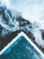 aerial view of ocean beside dock wallpaper