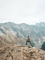 person standing on mountain scenery wallpaper