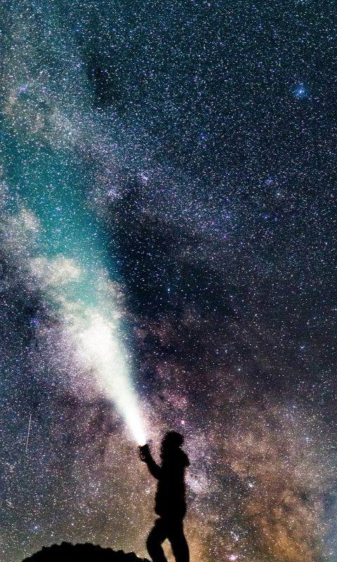 a sefie underneath the milky way wallpaper