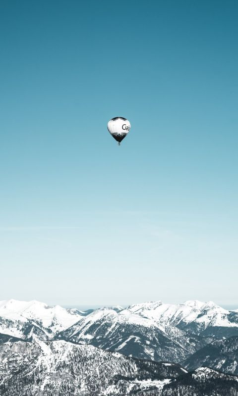 white and black hot air balloons in mid air wallpaper