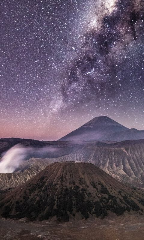 brown volcano under grey sky wallpaper