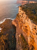 aerial photography of mountain beside sea wallpaper