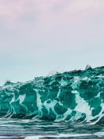 person surfing on sea waves during daytime wallpaper