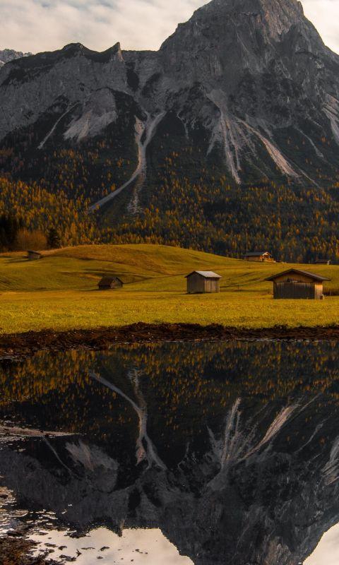 cabins in field wallpaper