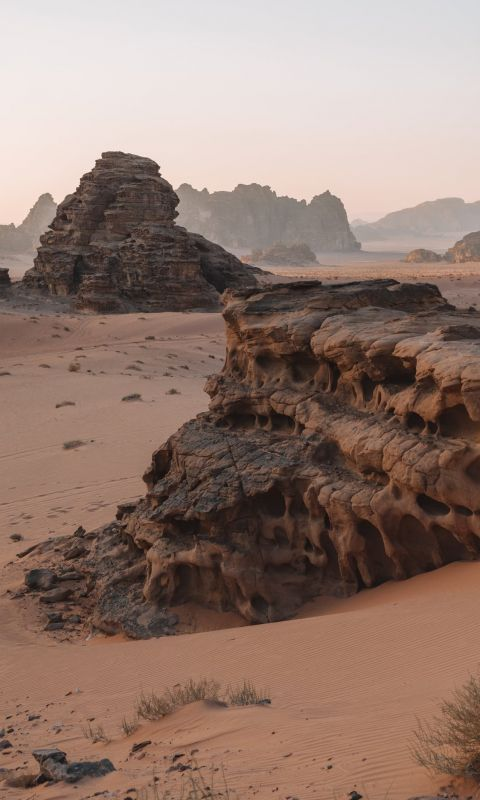 brown rock formation on brown field wallpaper