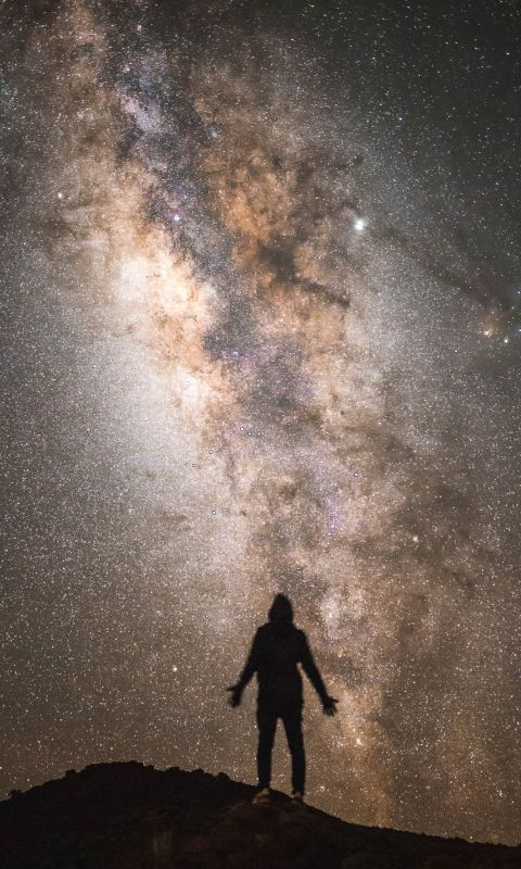 silhouette of a man with the Milky Way background wallpaper