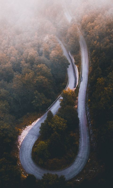 aerial photo of curved highway during daytime wallpaper
